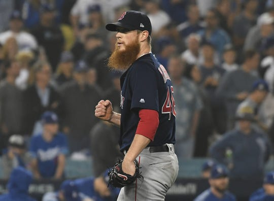 Red Sox reliever Craig Kimbrel celebrates after defeating the Dodgers in Game 4 of the 2018 World Series.
