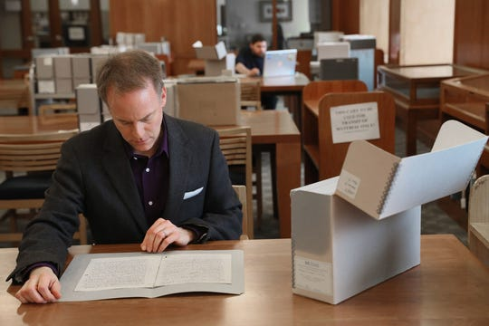 """Archivist Bill Fliss looks through some of the manuscripts in Marquette University's extensive J.R.R. Tolkien archives. Marquette owns notes, manuscripts and first drafts of """"The Hobbit,"""" """"Lord of the Rings"""" and other Tolkien works. Fliss has started collecting oral histories of Tolkien fans."""