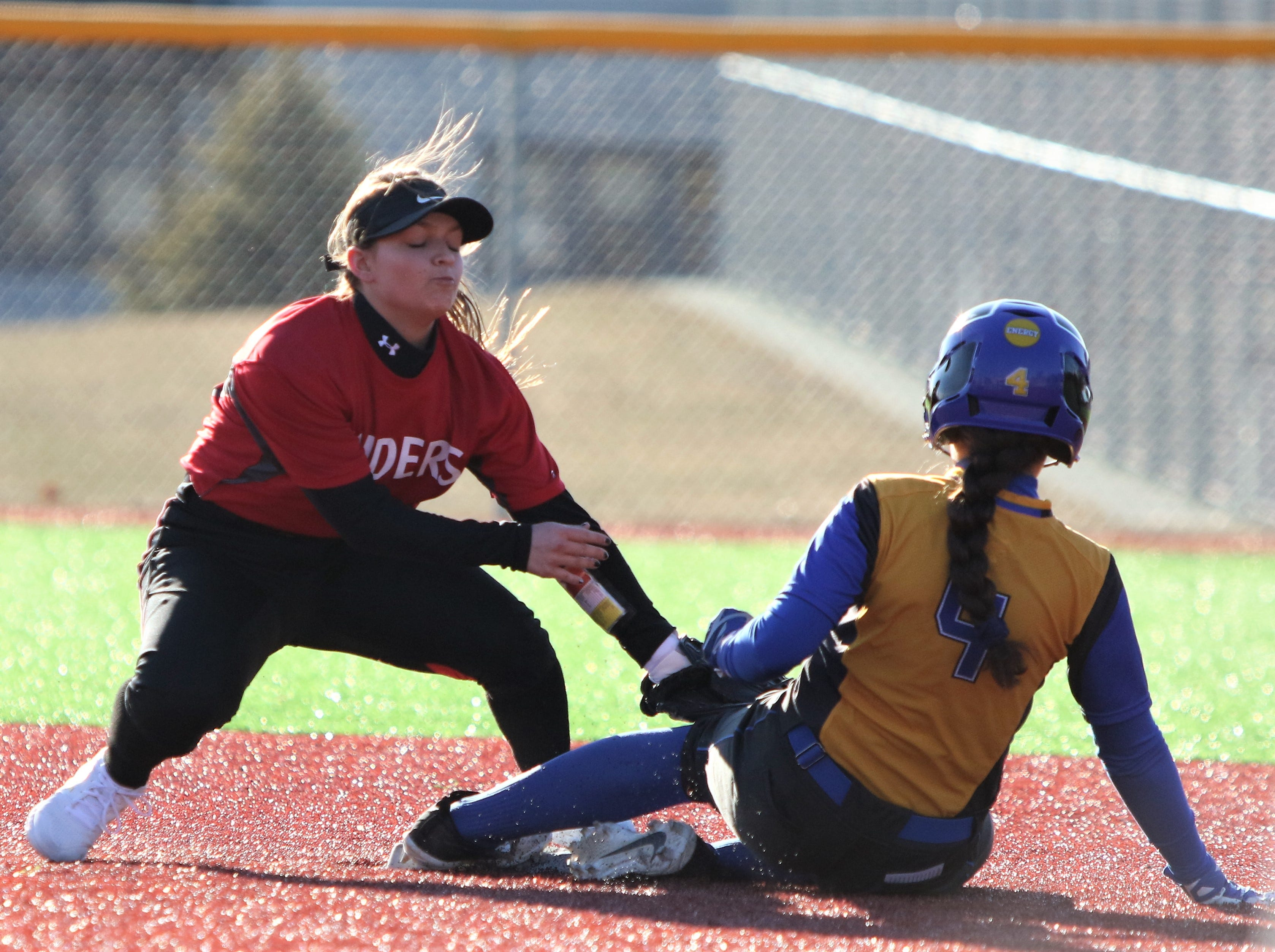 Catholic Memorial sophomore Maria Serb slides in safely at second base in a game against Wauwatosa East on March 19, 2019.