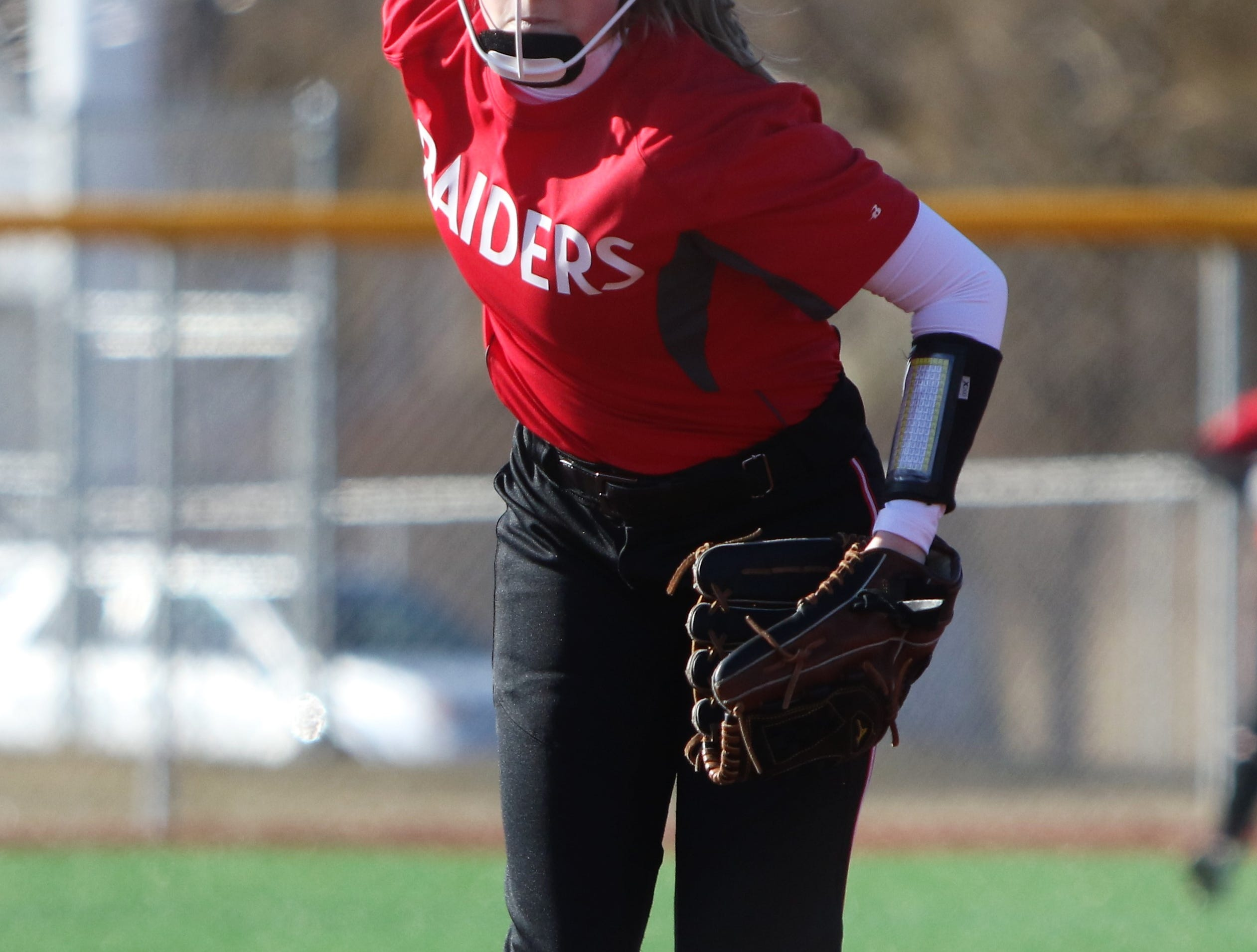 Wauwatosa East pitcher Stasia Raebel winds up against Catholic Memorial on March 19, 2019.