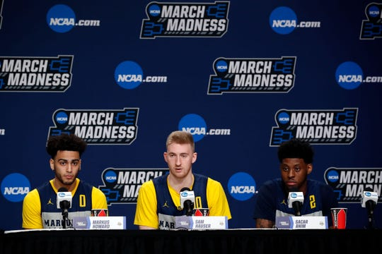 Marquette's Markus Howard, Sam Hauser and Sacar Anim (from left) answer questions on Wednesday at the XL Center in Hartford, Conn.