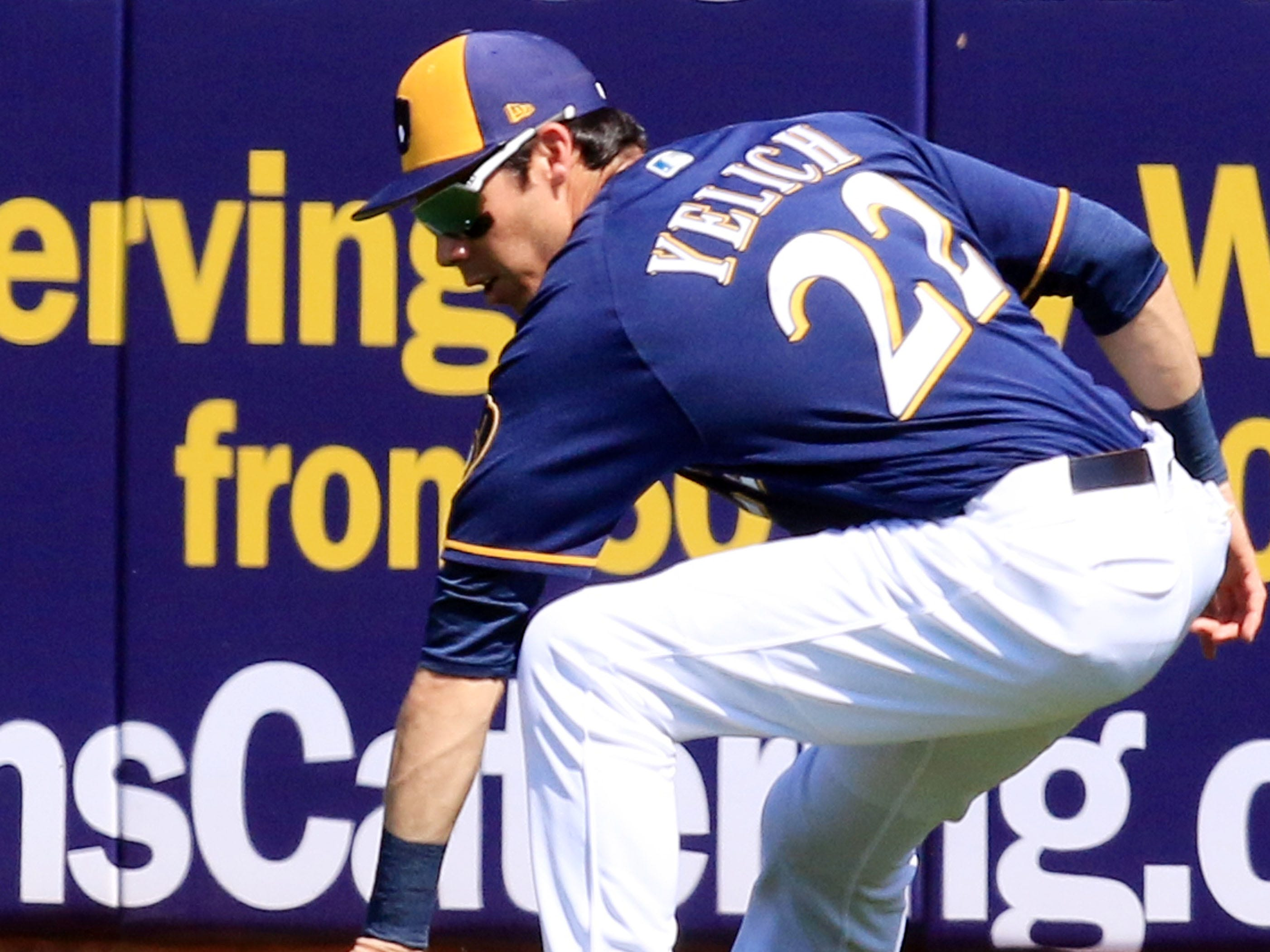 Brewers outfielder Christian Yelich picks up a single in the outfield.