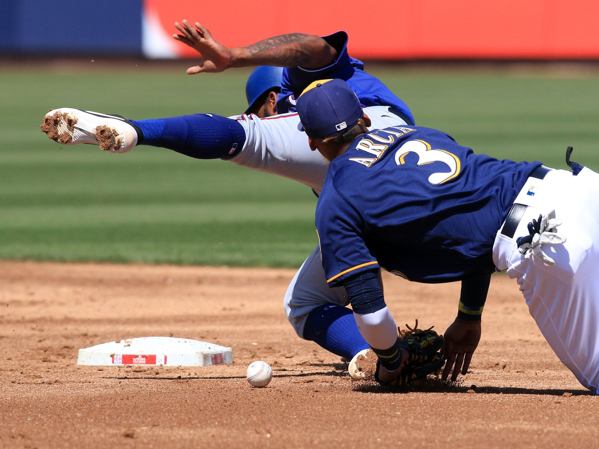 Brewers infielder Orlando Arcia is unable to make a play as he collides Danny Santana of Texas Tuesday afternoon.