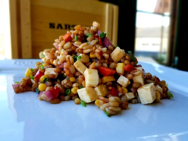 The chewiness of the wheat berries in this salad plays well with the soft Gouda cheese.
