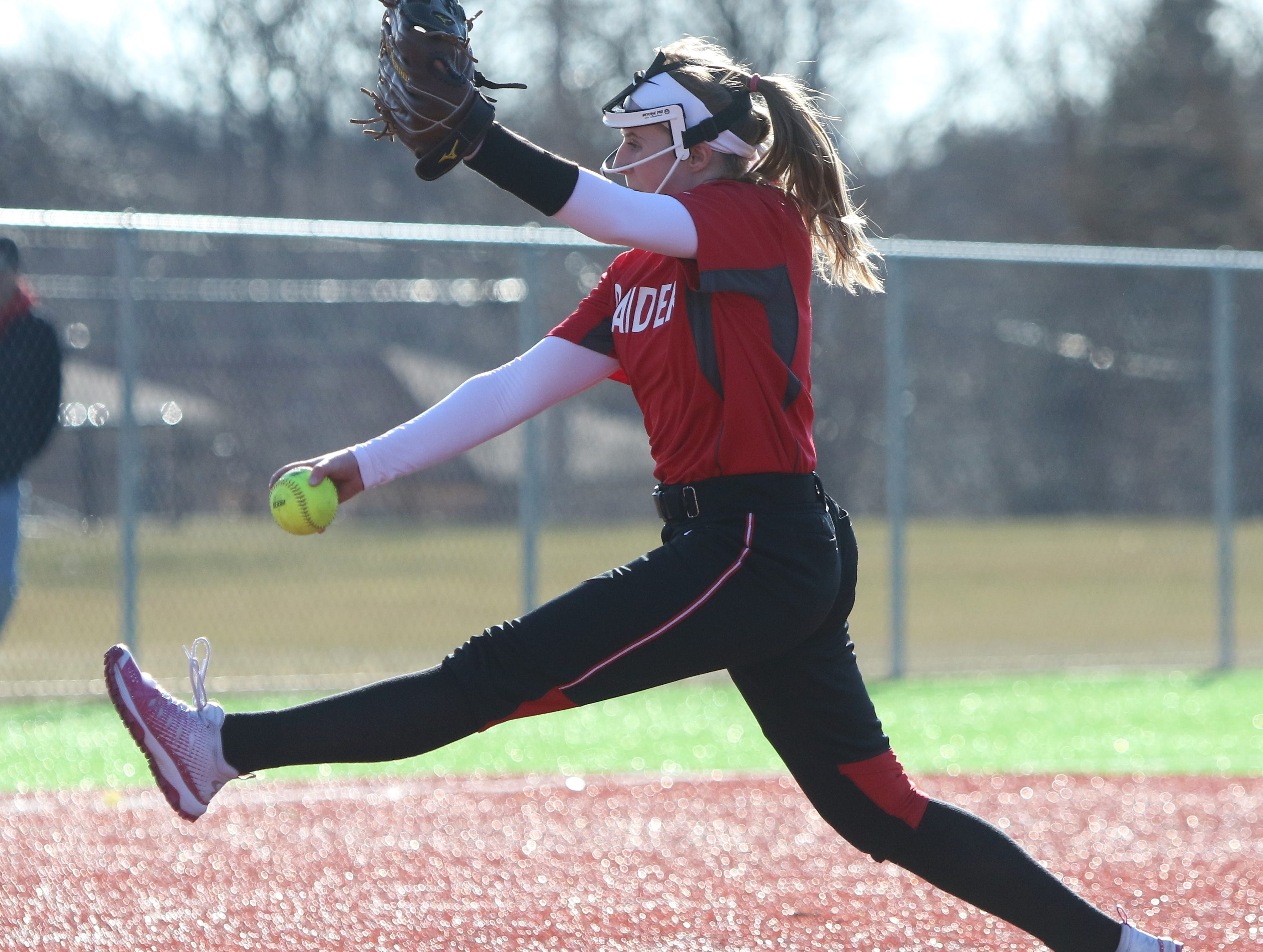 Wauwatosa East pitcher Stasia Raebel winds up for a pitch against Catholic Memorial on March 19, 2019.