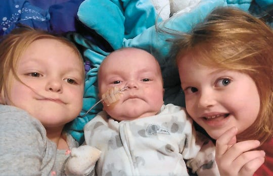 Billy McGrath enjoys time with his sisters, Ellie (left), 4, and Cece, 6.