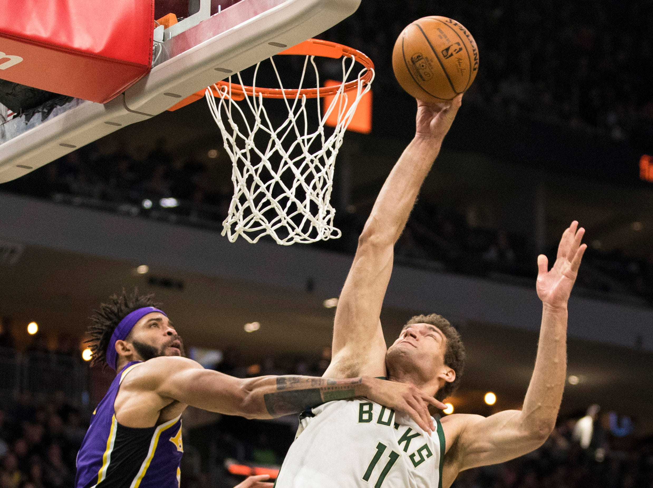 Mar 19, 2019; Milwaukee, WI, USA; Milwaukee Bucks center Brook Lopez (11) shoots the ball over Los Angeles Lakers guard Reggie Bullock (35) during the fourth quarter at Fiserv Forum. Mandatory Credit: Jeff Hanisch-USA TODAY Sports