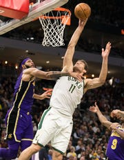 Brook Lopez gets shoots over Lakers guard Reggie Bullock on Tuesday night.