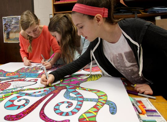 Fifth-graders Lauren Rohr (left), Mallory Herzog and Grace Medved work on a wall panel as part of an artist-in-residence project at Tonawanda Elementary School in 2015. Enrollments at Tonawanda and other elementary schools in the Elmbrook School District are projected to increase beyond capacity in the coming years.