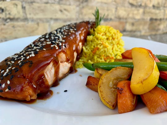 The Asian BBQ Atlantic Salmon is a favorite at Twisted Willow and is served with a local honey, hoisin BBQ glaze, toasted sesame seeds, sauteed seasonal vegetables and carrot basmati.