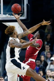 Arkansas' Adrio Bailey (2) shoots against Providence's Nate Watson during the first half of a NIT game Tuesday in Providence, R.I.