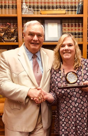 """Shirley Luna (right) is pictured receiving her 15-year award for her faithful and loyal service to the Spencer Law Firm and its clients from Rick Spencer. Luna stated that """"considering that I work for one of the very few workers' compensation claimant attorneys in Arkansas, to say that I have the opportunity to make a difference in the lives of those injured on the job is an understatement. Needless to say, it is an honor to provide assistance to the infirm, disabled and injured workers in this region and go home each day with confidence that my work has made a positive difference in the lives of many."""""""