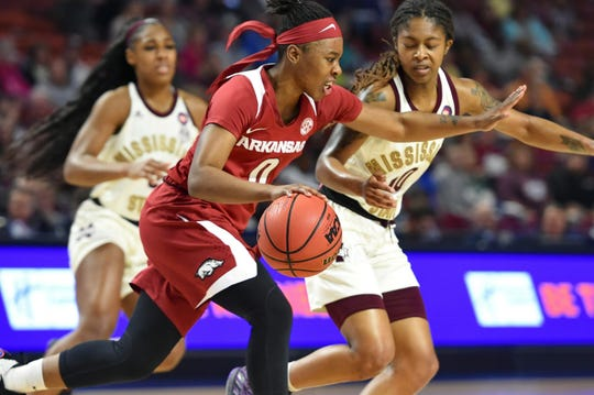 Arkansas's A'Tyanna Gaulden (center) drives while defended by Mississippi Sate's Jazzmun Holmes (right) and Anriel Howard during Souteastern Conference championship game in Greenville, S.C.