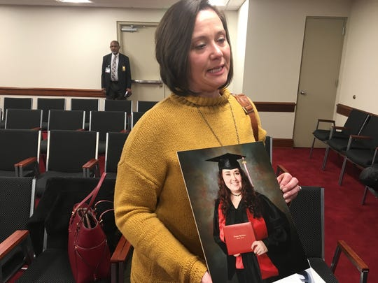 Michelle Lunsford holds up a picture of her daughter Camryn Callaway on March 20, 2019. Callaway died in an incident of distracted driving, and Lunsford spoke to a House committee in support of a bill to extend the state's current ban on texting-while-driving.