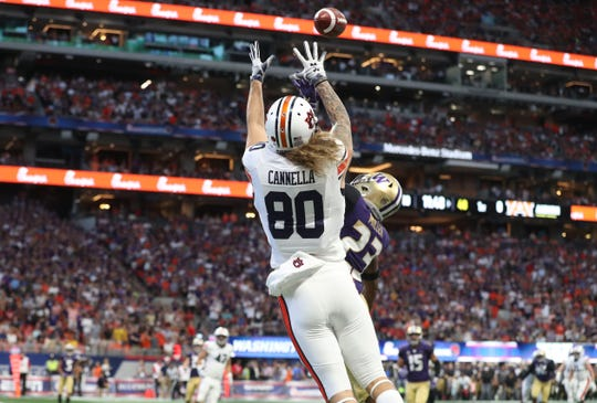 Auburn wide receiver Sal Cannella (80) scores a touchdown against Washington defensive back Jordan Miller (23) at Mercedes-Benz Stadium on Sept. 3, 2018, in Atlanta.