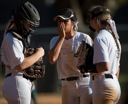 Autauga's pitcher Karysn Kemsel (3) talks with teammates at the mound at Autauga Academy in Prattville, Ala., on Tuesday, March 19, 2019.