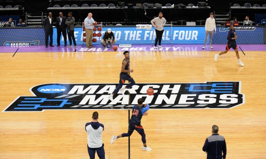 Auburn guard J'Von McCormick (12) passes to center Anfernee McLemore (24) during practice before the first round of the 2019 NCAA Tournament at Vivint Smart Home Arena on March 20, 2019, in Salt Lake City.