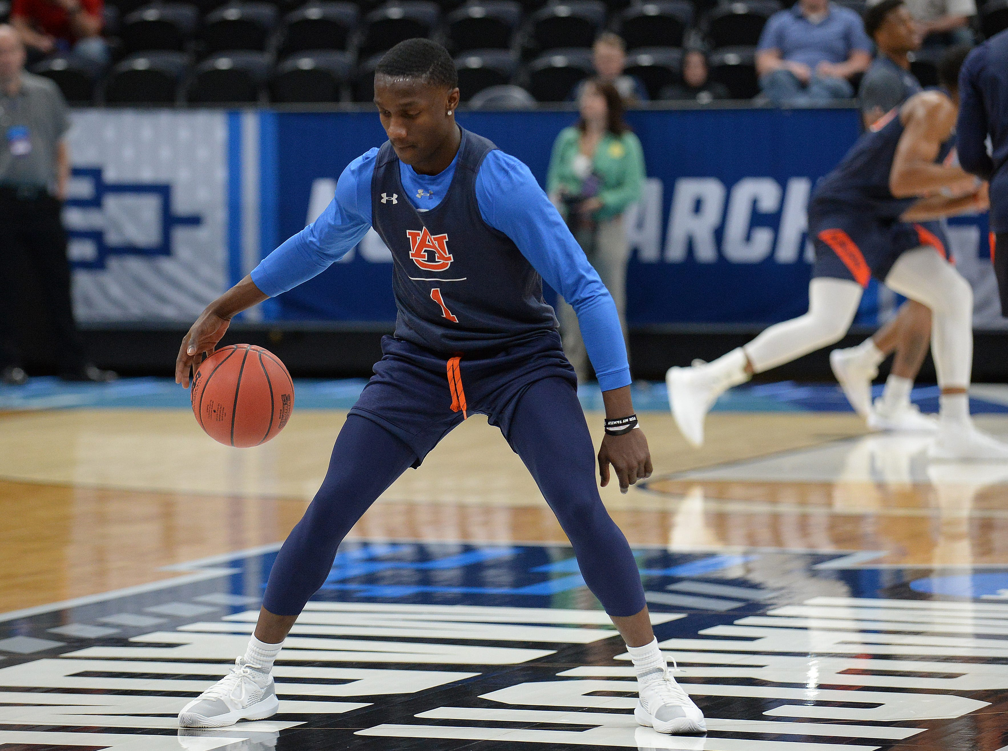 March 20, 2019; Salt Lake City, UT, USA; Auburn Tigers guard Jared Harper (1) during practice before the first round of the 2019 NCAA Tournament at Vivint Smart Home Arena. Mandatory Credit: Gary A. Vasquez-USA TODAY Sports