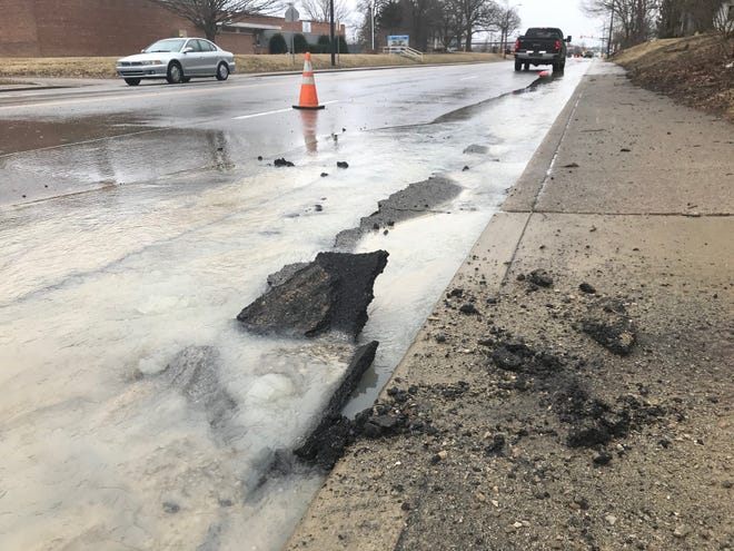 Water flows down Madison street Tuesday afternoon following a main break. Southbound lanes of Madison have been closed.