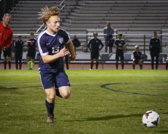 Siegel's Carson Shoemaker chases the ball during Tuesday's match against Oakland. Shoemaker had a goal and assist in a 2-1 win.