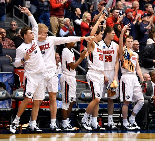 Belmont players react to a three-pointer during the second half of the NCAA college basketball tournament First Four game against Temple at the University of Dayton Arena in Dayton, Ohio, Tuesday, March 19, 2019.