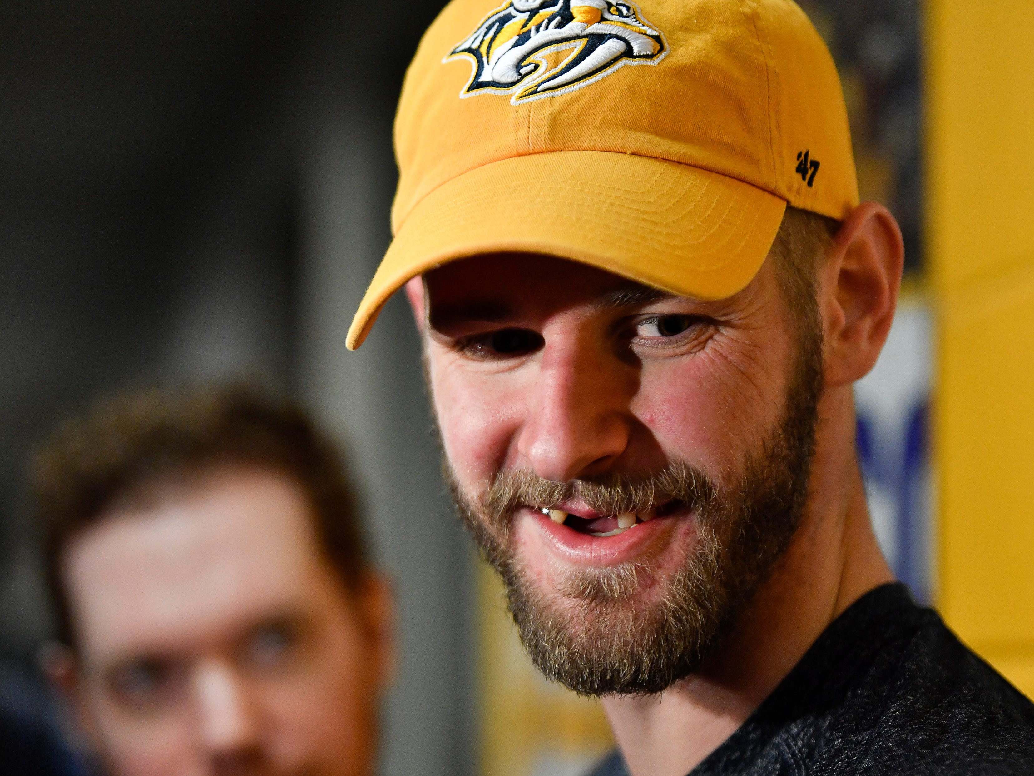 Predators left wing Austin Watson (51) smiles as he takes questions from the media after his first practice at Centennial Sportsplex after serving an NHL suspension Wednesday, March 20, 2019 in Nashville, Tenn.