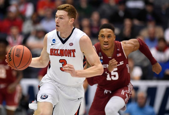 Belmont guard/forward Dylan Windler (3) moves the ball as Temple guard Nate Pierre-Louis (15) tries to keep up during the first half of the NCAA college basketball tournament First Four game at the University of Dayton Arena in Dayton, Ohio, Tuesday, March 19, 2019.