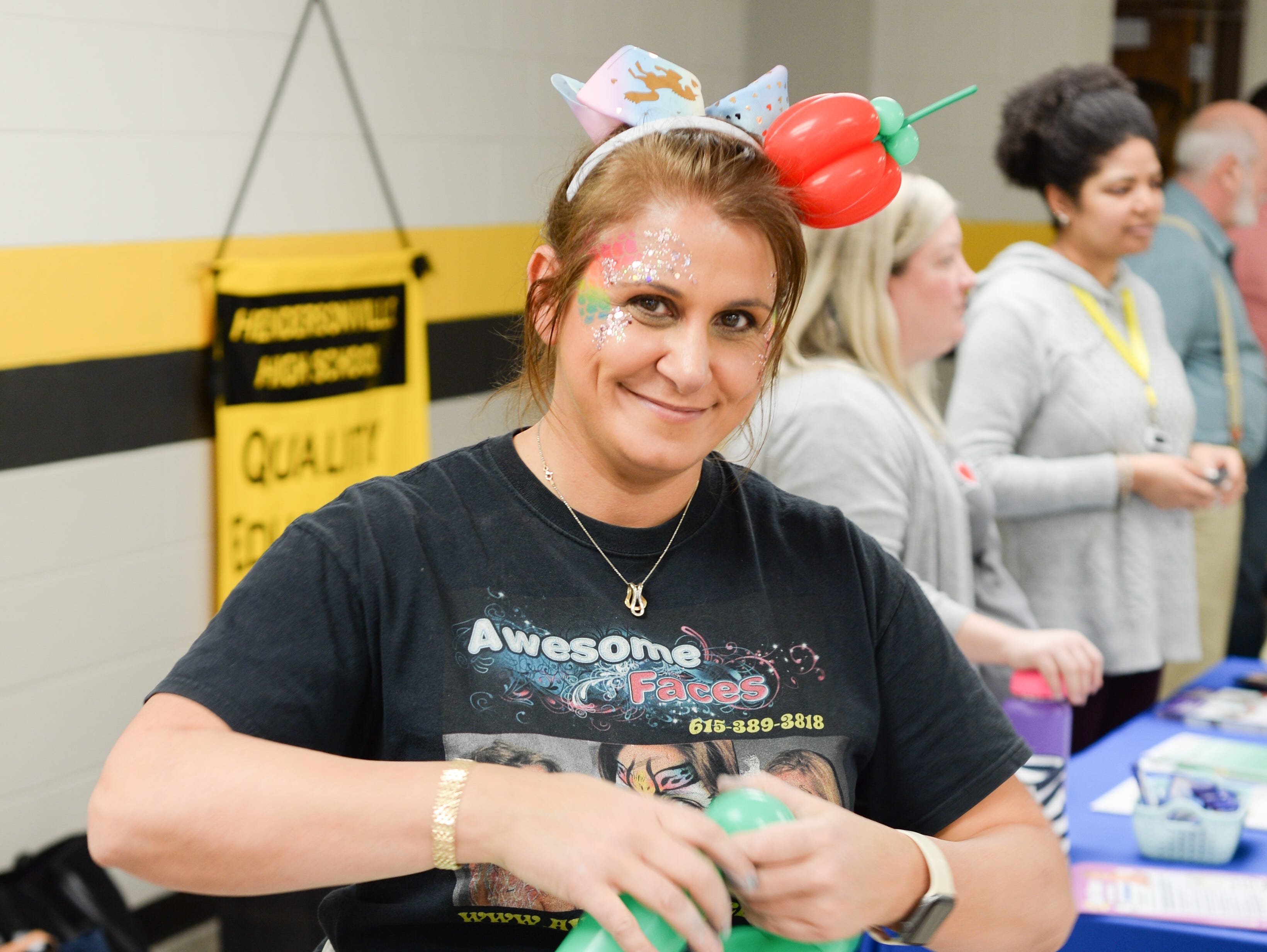 Amanda from Awesome Faces adds color to the Mid TN Babies and Beyond Fest and Be Healthy Hendersonville Expo Presented by Hendersonville Area Chamber of Commerce at Hendersonville High School on Saturday, March 16.
