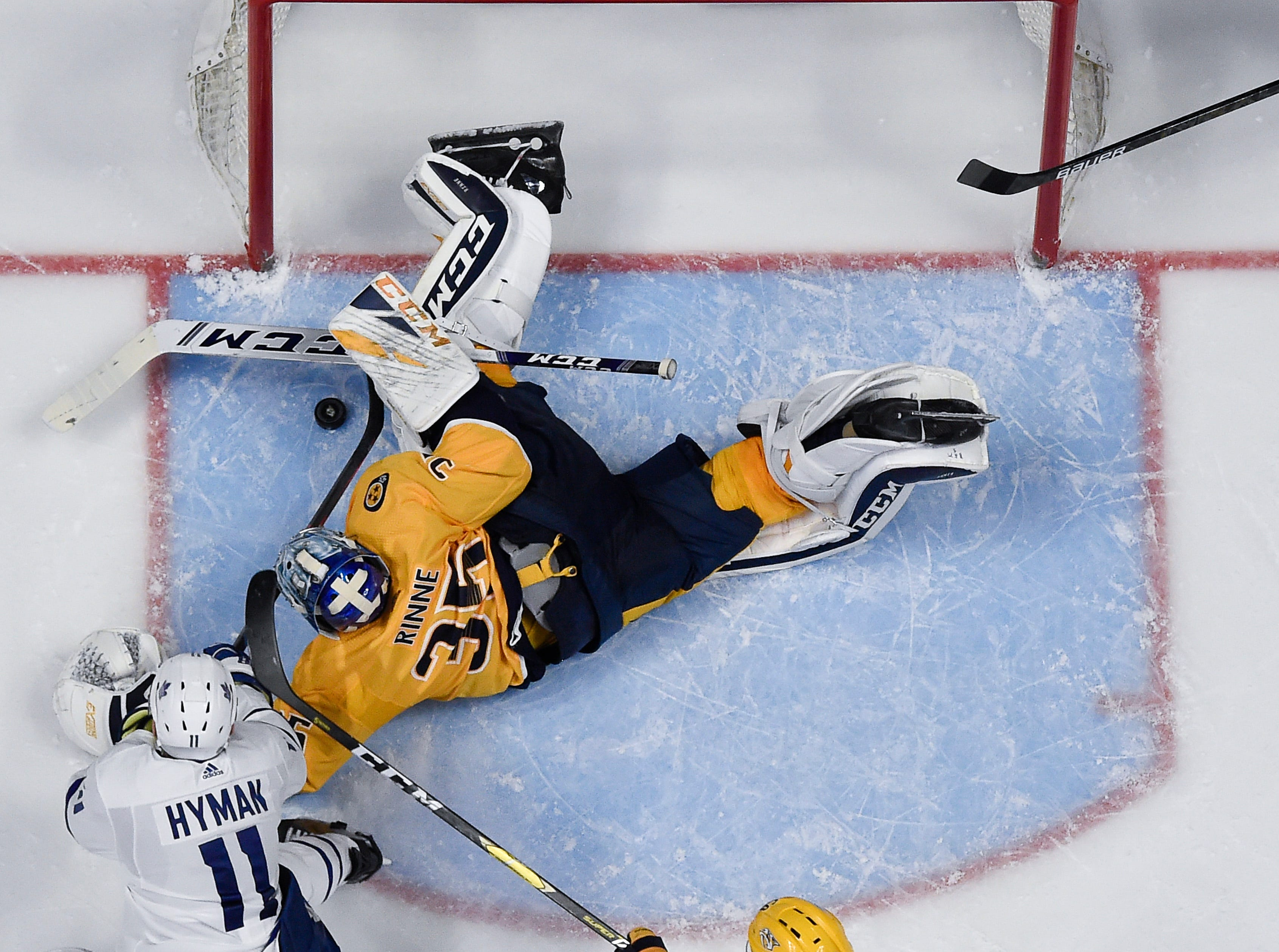 Predators goaltender Pekka Rinne (35) defend the puck against Maple Leafs left wing Zach Hyman (11) during the third period at Bridgestone Arena Tuesday, March 19, 2019 in Nashville, Tenn.