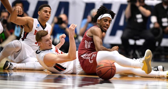 Belmont guard/forward Dylan Windler (3) and Temple guard Quinton Rose (1) hit the floor during the first half of the NCAA college basketball tournament First Four game at the University of Dayton Arena in Dayton, Ohio, Tuesday, March 19, 2019.