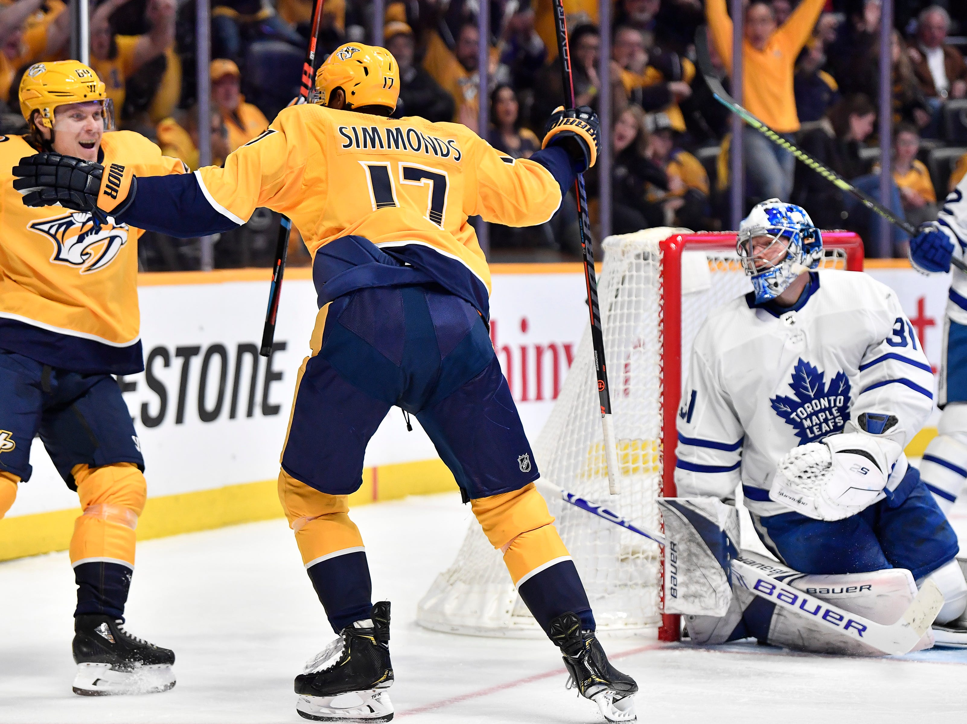 Mar. 19, 2019: Predators 3 Maple Leafs 0 -- Predators center Mikael Granlund (64) congratulates right wing Wayne Simmonds (17) after his goal against Maple Leafs goaltender Frederik Andersen (31) during the third period at Bridgestone Arena Tuesday, March 19, 2019 in Nashville, Tenn.