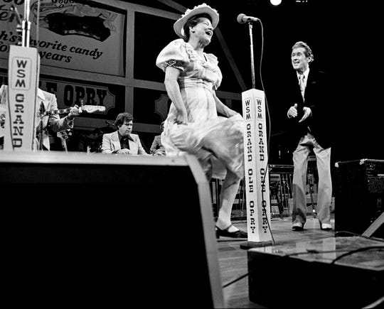 Grand Ole Opry show host Roy Acuff, right, looks on as star Minnie Pearl dances to the music before a sold-out audience at the Grand Ole Opry House on March 3, 1979.