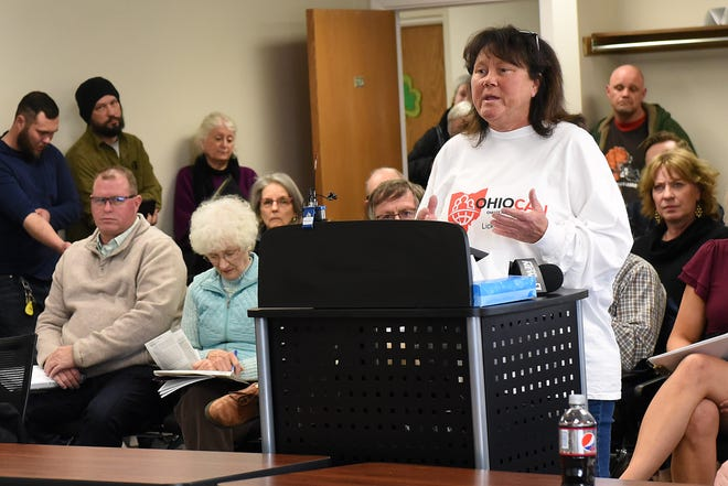 Trish Perry, who helps the homeless  and drug addicts in Licking County, tells the health board about watching her son struggle with addiction and the medical side affects of using drugs with an unclean needle.