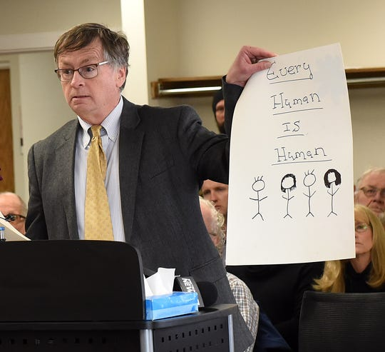 Dennis Cauchon, president of the Granville-based non-profit Harm Reduction Ohio, holds one of the signs used during the group's protest before the Licking County Board of Health's monthly meeting. Cauchon questioned the board's 8-0 vote against establishing a needle exchange program.