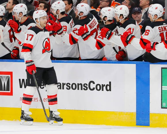 New Jersey Devils forward Kenny Agostino (17) celebrates after scoring a goal in the first period against the Edmonton Oilers at Rogers Place on March 13, 2019.