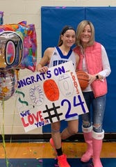 NV/Demarest's Meadow Garcia celebrating her 1,000-points milestone with her mother, Gina Romano.