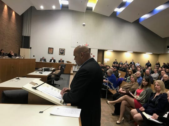 Clifton PBA VIce President Derek Fogg addresses the Clifton City Council Tuesday night over the issue of pay of officers serving in National Guard
