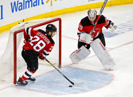 New Jersey Devils defenseman Damon Severson (28) makes a save in front of Devils goaltender Mackenzie Blackwood (29) against the Washington Capitals during the third period at Prudential Center in Newark on March 19, 2019.