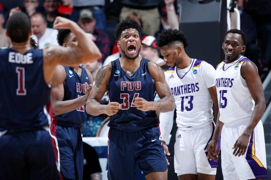 Mike Holloway Jr. #34 of the Fairleigh Dickinson Knights celebrates during the second half against the Prairie View A&M Panthers in the First Four of the 2019 NCAA Men's Basketball Tournament at UD Arena on March 19, 2019 in Dayton, Ohio.