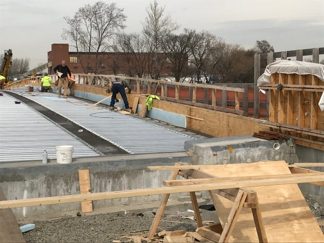 Workers building the new Eighth Street Bridge that connects Passaic with Wallington.