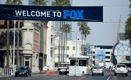 Cars enter and leave Fox Studios, Tuesday, March 19, 2019, in Los Angeles. Disney has closed its $71 acquisition of Fox's entertainment business on Wednesday, March 20, in a move set to shake up the media landscape.