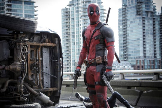"This image released by Twentieth Century Fox shows Ryan Reynolds in a scene from the film, ""Deadpool."" When Walt Disney Co.'s $71.3 billion acquisition of Fox is completed at 12:02 a.m. Wednesday, Disney will add the R-rated superhero Deadpool, the X-Men and the Fantastic Four to its bench of Marvel characters."