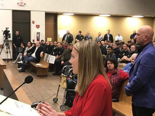Jennifer Marks, wife of Clifton detective Robert deployed overseas, todl the City Council Tuesday they felt abandoned by the city when her husband received a letter threatening to dock his pay.