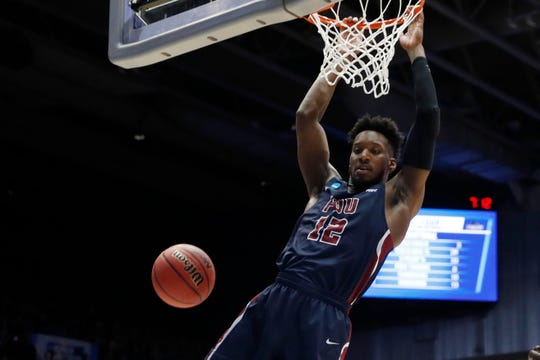 Mar 19, 2019; Dayton, OH, USA; Fairleigh Dickinson Knights forward Kaleb Bishop (12) hangs from the basket in the first half against the Prairie View A&M Panthers in the First Four of the 2019 NCAA Tournament at Dayton Arena.