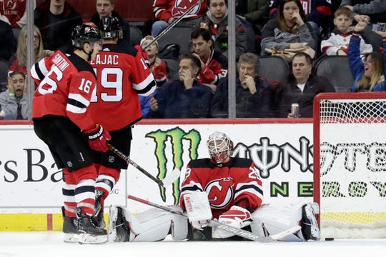 New Jersey Devils goaltender MacKenzie Blackwood, right, reacts after allowing a goal to Washington Capitals right wing Tom Wilson, not pictured, during the second period of an NHL hockey game, Tuesday, March 19, 2019, in Newark, N.J.