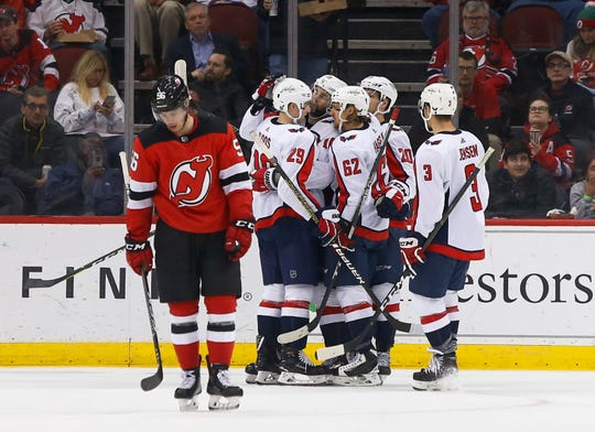 Washington Capitals players celebrate a goal against the New Jersey Devils during the second period at Prudential Center.