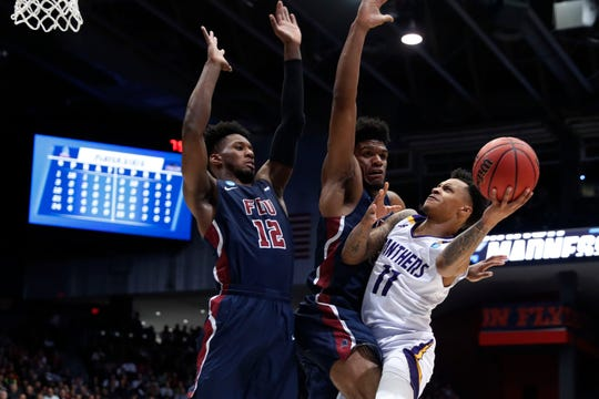 Mar 19, 2019; Dayton, OH, USA; Prairie View A&M Panthers guard Dennis Jones (11) looks to shoot around Fairleigh Dickinson Knights forward Kaleb Bishop (12) and  Mike Holloway Jr. (34) in the First Four of the 2019 NCAA Tournament at Dayton Arena.