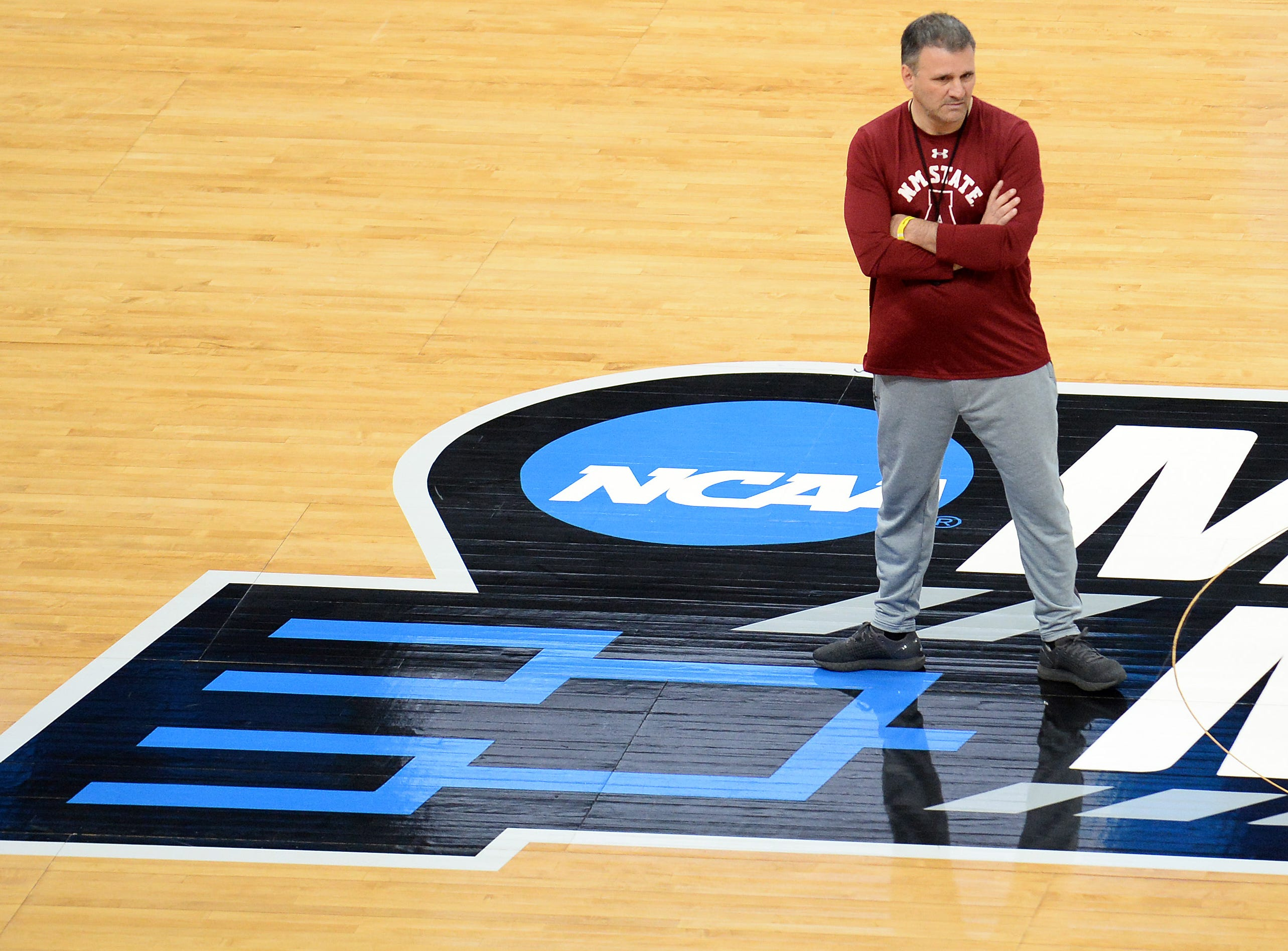 March 20, 2019; Salt Lake City, UT, USA; New Mexico State Aggies head coach Chris Jans watches practice before the first round of the 2019 NCAA Tournament at Vivint Smart Home Arena. Mandatory Credit: Gary A. Vasquez-USA TODAY Sports