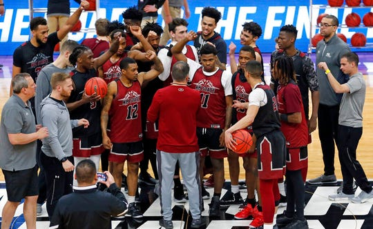 New Mexico State players gather for a photograph during practice at the NCAA men's college basketball tournament Wednesday, March 20, 2019, in Salt Lake City.