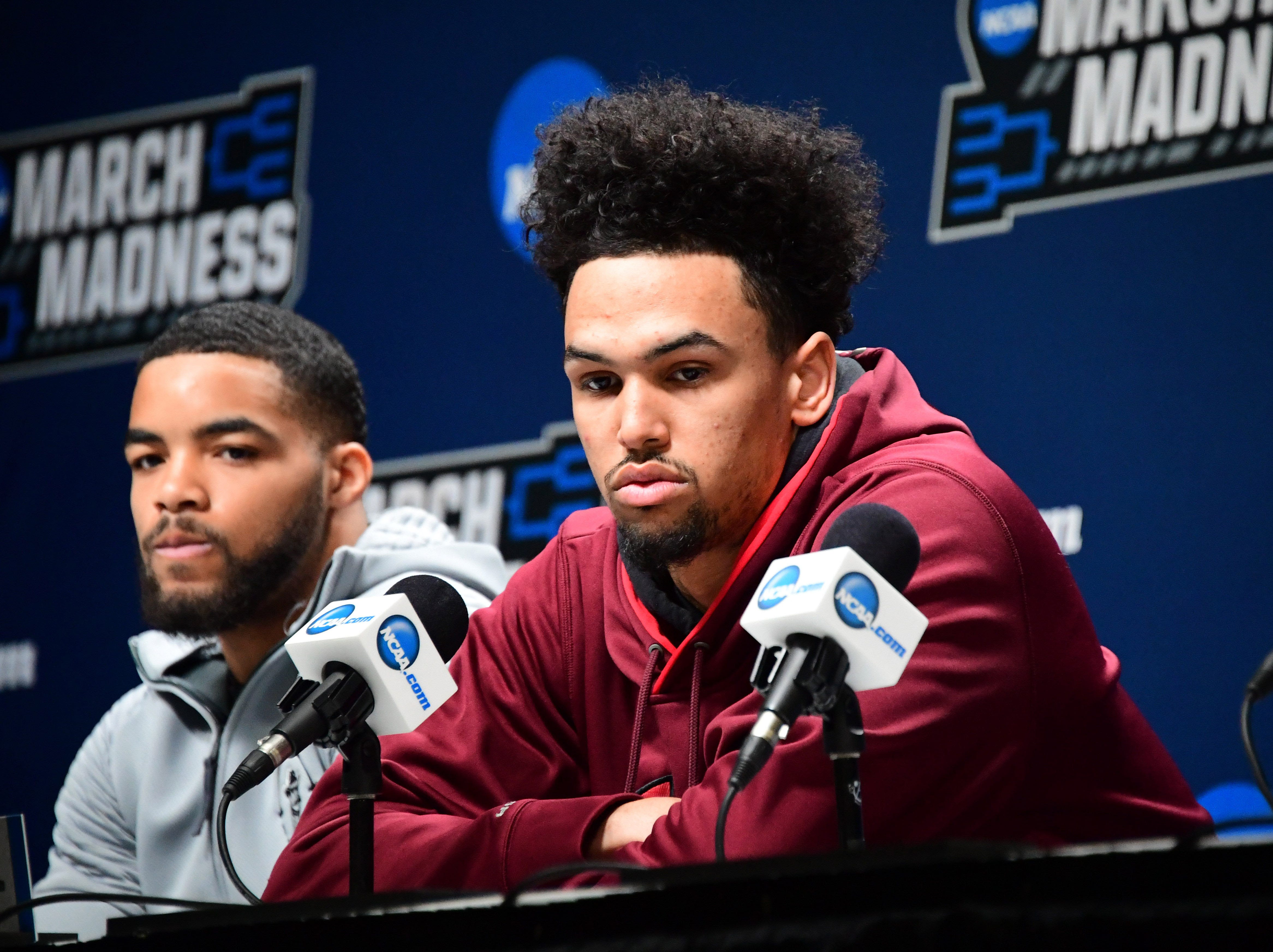 Mar 20, 2019; Salt Lake City, UT, USA; New Mexico State Aggies guard Shunn Buchanan (left) and forward Eli Chuha during a press conference  before the first round of the 2019 NCAA Tournament at Vivint Smart Home Arena. Mandatory Credit: Kirby Lee-USA TODAY Sports